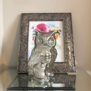 Two silver light up owls